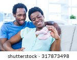 happy couple looking at baby... | Shutterstock . vector #317873498