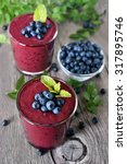 glasses of blueberry smoothie... | Shutterstock . vector #317895746