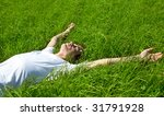young adult man in spring grass | Shutterstock . vector #31791928