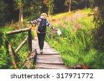young woman enjoying a hike... | Shutterstock . vector #317971772