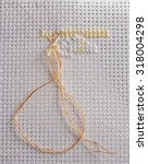 cross stitch on a white canvas... | Shutterstock . vector #318004298