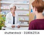 senior lady pharmacist... | Shutterstock . vector #318062516