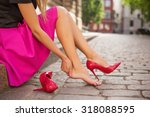 woman with injured foot | Shutterstock . vector #318088595