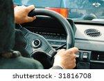 driver's hands on steering wheel | Shutterstock . vector #31816708