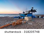 a blue fishing boat at sunrise... | Shutterstock . vector #318205748