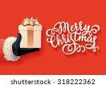 santa holding christmas gift  | Shutterstock .eps vector #318222362
