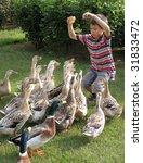young boy with ducks