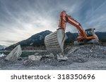 big orange digger on gravel... | Shutterstock . vector #318350696