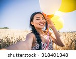 attractive woman with balloons... | Shutterstock . vector #318401348
