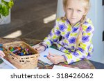 Little Child Drawing A Pastel...