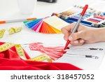 fashion designer working in... | Shutterstock . vector #318457052