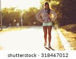 tired female runner taking a... | Shutterstock . vector #318467012