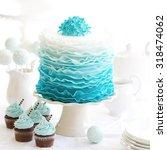 ombre ruffle cake on a dessert... | Shutterstock . vector #318474062