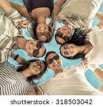 group of friends on the beach... | Shutterstock . vector #318503042