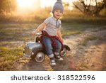 toddler posing with toy race car | Shutterstock . vector #318522596