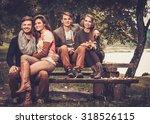 cheerful friends in autumn park | Shutterstock . vector #318526115