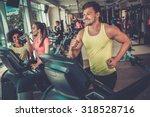man running on a treadmill in a ... | Shutterstock . vector #318528716