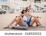 Two Teen Girl Friends Having...