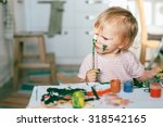 happy cute toddler painting... | Shutterstock . vector #318542165