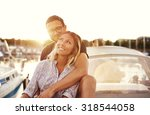 happy couple on a boat ... | Shutterstock . vector #318544058