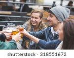 group of friends enjoying a... | Shutterstock . vector #318551672