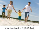 photo of happy parents holding... | Shutterstock . vector #31855169