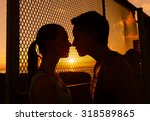 Young Couple Kissing In A...
