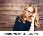 smiling fashionable blonde... | Shutterstock . vector #318602492