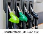 fuel pistols at petrol station. | Shutterstock . vector #318664412