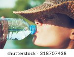 woman drinking water in summer... | Shutterstock . vector #318707438