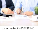 business colleagues working... | Shutterstock . vector #318712748