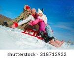ecstatic family on sledge... | Shutterstock . vector #318712922
