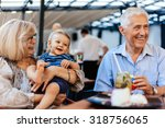 grandparents with their... | Shutterstock . vector #318756065