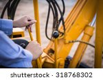 The Man Driving Excavator Or...