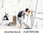 young man with backpack looking ... | Shutterstock . vector #318789248