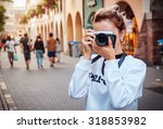 young woman with camera... | Shutterstock . vector #318853982