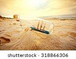 ship in the bottle lying on the ... | Shutterstock . vector #318866306