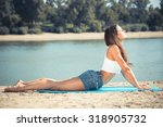 a young girl does gymnastics in ... | Shutterstock . vector #318905732