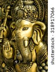 Small photo of Golden Hindu God Ganesh