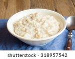 oatmeal porridge in bowl for... | Shutterstock . vector #318957542