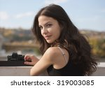 young woman photographer with... | Shutterstock . vector #319003085