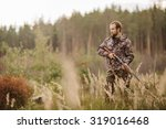 male hunter in camouflage... | Shutterstock . vector #319016468