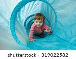 Small Toddler Playing In A...