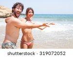 happy couple in a beach | Shutterstock . vector #319072052