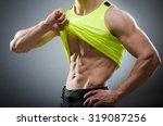 muscular man posing in dark... | Shutterstock . vector #319087256