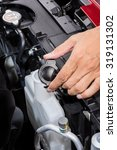 opening coolant container in... | Shutterstock . vector #319131302
