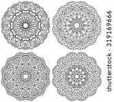 set of ethnic round ornaments.... | Shutterstock .eps vector #319169666