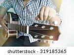 acoustic guitar playing. men... | Shutterstock . vector #319185365