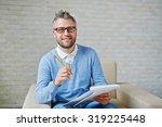 male psychiatrist with pencil... | Shutterstock . vector #319225448