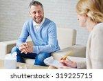 happy patient talking to... | Shutterstock . vector #319225715